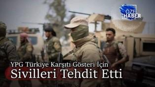 YPG Münbiç'te sivilleri gösteriye zorladı!