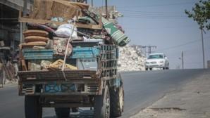 124 thousand civilians fleeing the air strikes on the border with Turkey